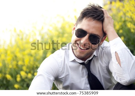 Portrait of a handsome young business man with sunglasses - stock photo
