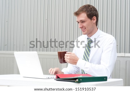 portrait of a handsome young businessman at desk