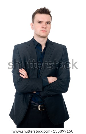 Portrait of a handsome young businessman staring against isolated white background - stock photo