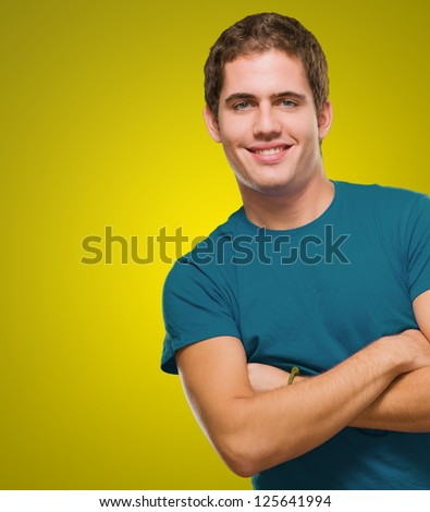 Portrait Of A Handsome Young Guy against a yellow background