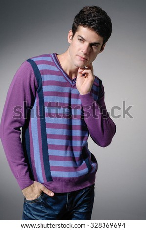 Portrait of a handsome young male in sweater dress-light background - stock photo