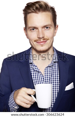 Portrait of a handsome young man drinking coffee. Isolated on white background. - stock photo