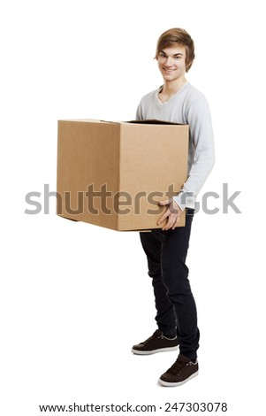 Portrait of a handsome young man holding a card box
