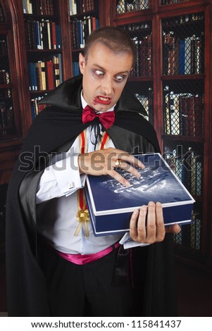portrait of a handsome young man in a suit of Count Dracula