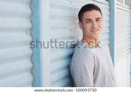 portrait of a handsome young man in athletic wear - stock photo