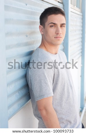 portrait of a handsome young man in athletic wear