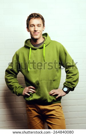 Portrait of a handsome young man in casual clothes. Studio shot. - stock photo