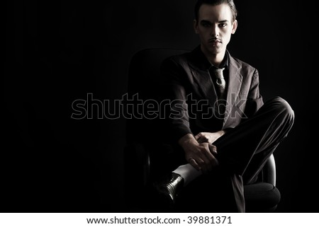 Portrait of a handsome young man in elegant suit. - stock photo