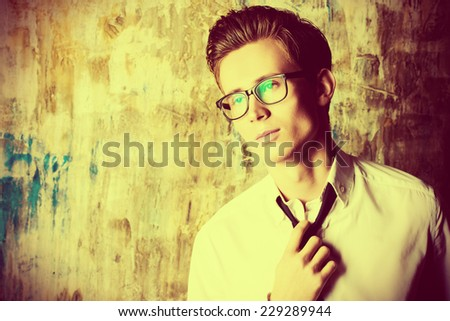 Portrait of a handsome young man in elegant suit and spectacles. - stock photo