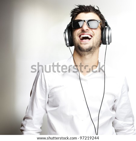 portrait of a handsome young man listening to music indoor