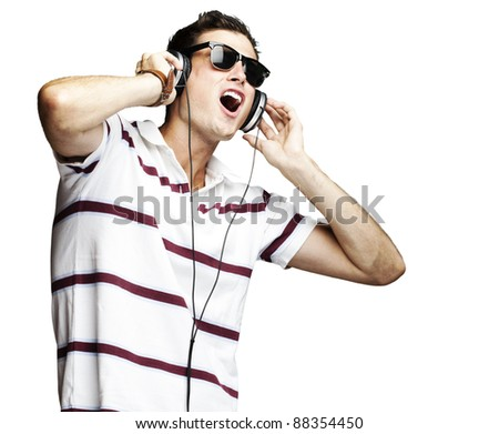 portrait of a handsome young man listening to music over white background - stock photo