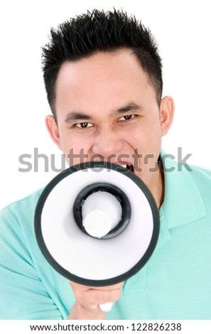 Portrait of a handsome young man making announcement over a megaphone isolated on white background