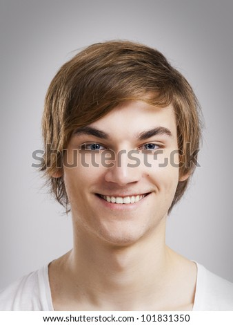Portrait of a handsome young man, over a gray background