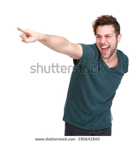 Portrait of a handsome young man smiling and pointing finger on isolated white background - stock photo