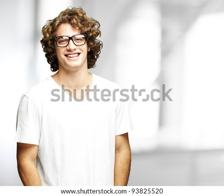 portrait of a handsome young man smiling indoor