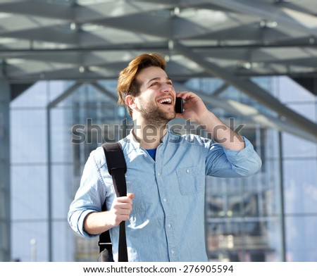 Portrait of a handsome young man talking on cell phone - stock photo