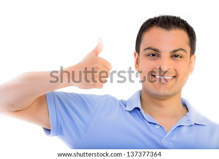Portrait of a handsome young man, thumbs up over white background - stock photo