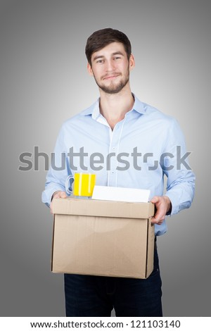 Portrait of a handsome young man with a box