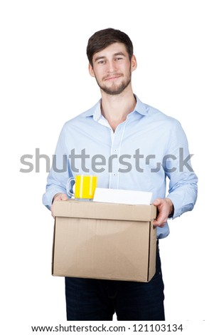 Portrait of a handsome young man with a box. Isolated - stock photo