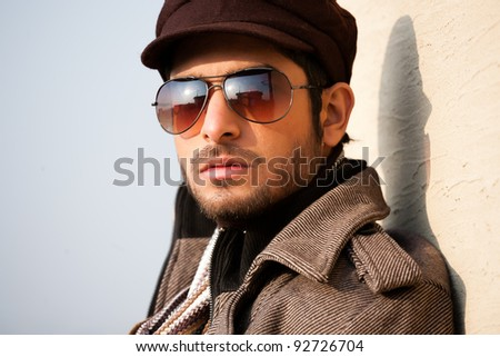 portrait of a handsome young man with attitude, portrait of a handsome man wearing jacket and sunglasses
