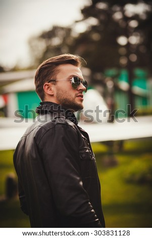 Portrait of a handsome young man with bristle and sunglasses - stock photo