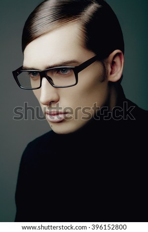 Portrait of a handsome young man with glasses
