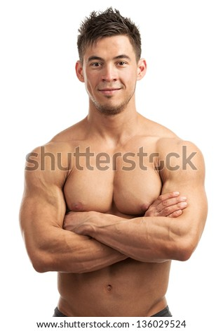 Portrait of a handsome young man with great physique posing against white background - stock photo