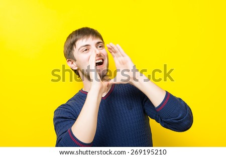 Portrait of a handsome young man yelling, - stock photo