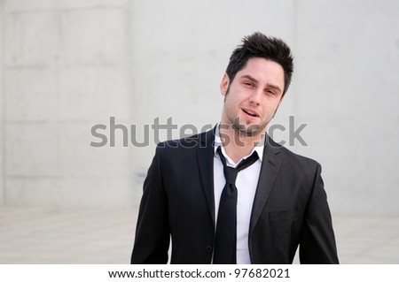 Portrait of a handsome young smiling business man - stock photo