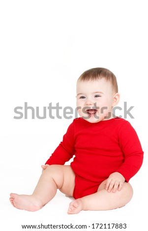 portrait of a happy adorable Infant child baby girl lin red sitting happy smiling on a white background
