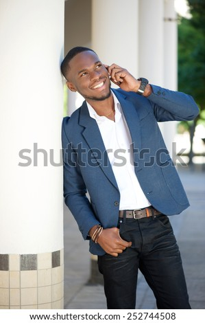 Portrait of a happy african american businessman calling by mobile phone - stock photo