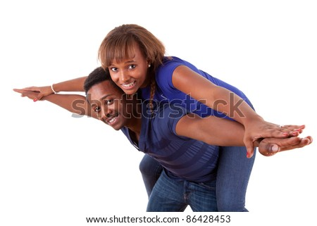 Portrait of a happy african american couple having fun together against white background - stock photo