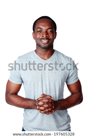 Portrait of a happy african man over white background - stock photo