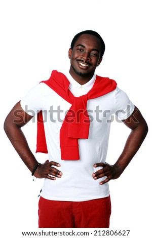 Portrait of a happy african man standing over white background