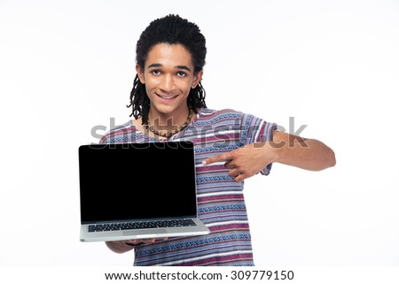 Portrait of a happy afro american man pointing finger on blank laptop screen isolated on a white background and looking at camera