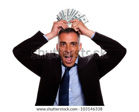 Portrait of a happy and excited man celebrating a victory while holding cash money above the head on isolated background - stock photo