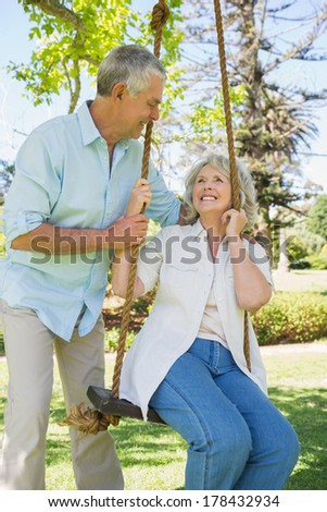 Portrait of a happy and loving mature couple at the park - stock photo