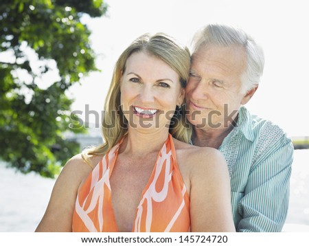 Portrait of a happy and romantic middle aged couple outdoors - stock photo