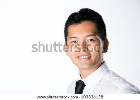 Portrait of a Happy Asian business man. - stock photo