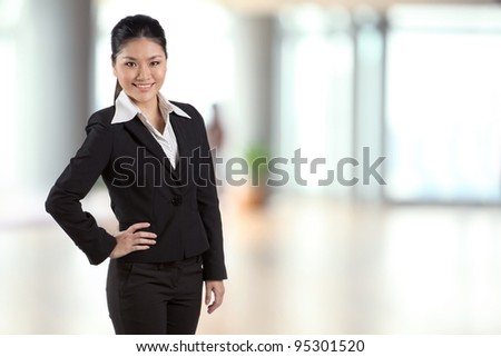 Portrait of a happy Asian business woman. - stock photo