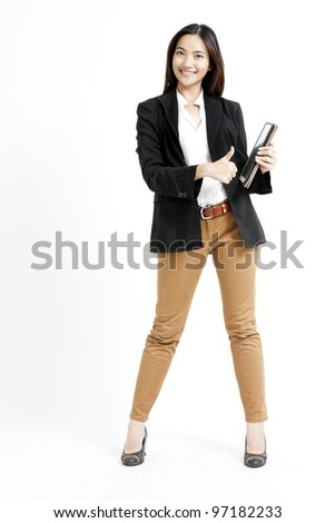 Portrait of a happy Asian business woman holding a tablet PC and show hand sign.
