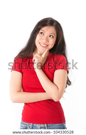 Portrait of a happy Asian woman looking up into the corner. - stock photo