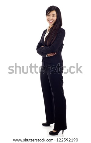 Portrait of a happy Asian young business woman standing with folded hands isolated over white background