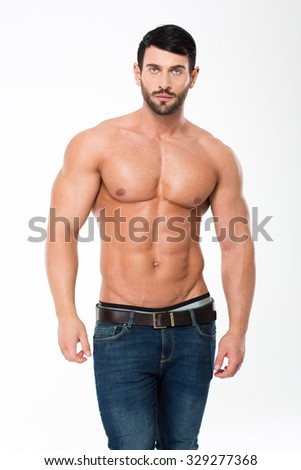 Portrait of a happy athletic man with muscular torso standing isolated on a white background - stock photo