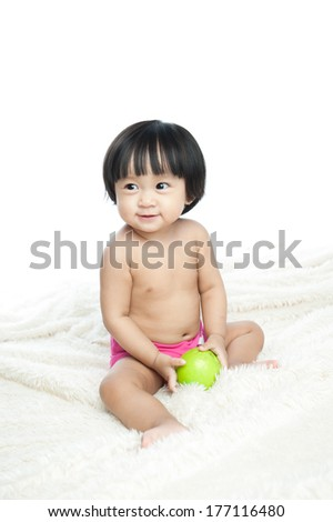 Portrait of a happy baby sitting on the blanket, isolated white background - stock photo