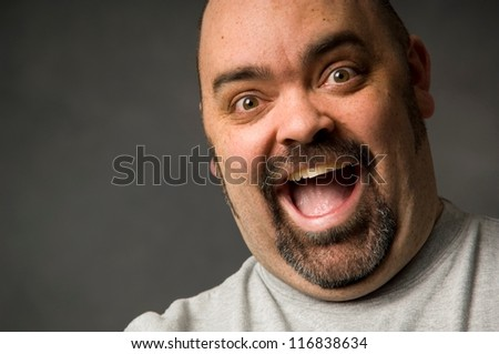 Portrait of a happy bald man - stock photo