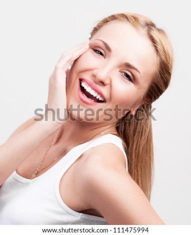 portrait of a happy beautiful laughing woman, against white background - stock photo