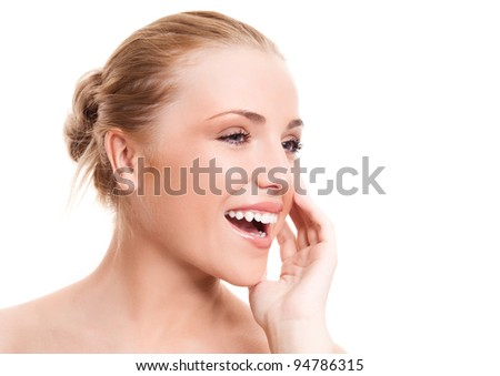 portrait of a happy beautiful laughing woman touching her cheek, isolated against white background