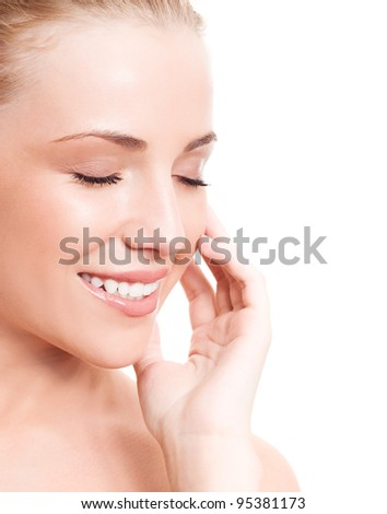 portrait of a happy beautiful smiling woman touching her face, isolated against white background, copyspace for your text to the right