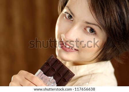 portrait of a happy beautiful woman and chocolate in his hands - stock photo